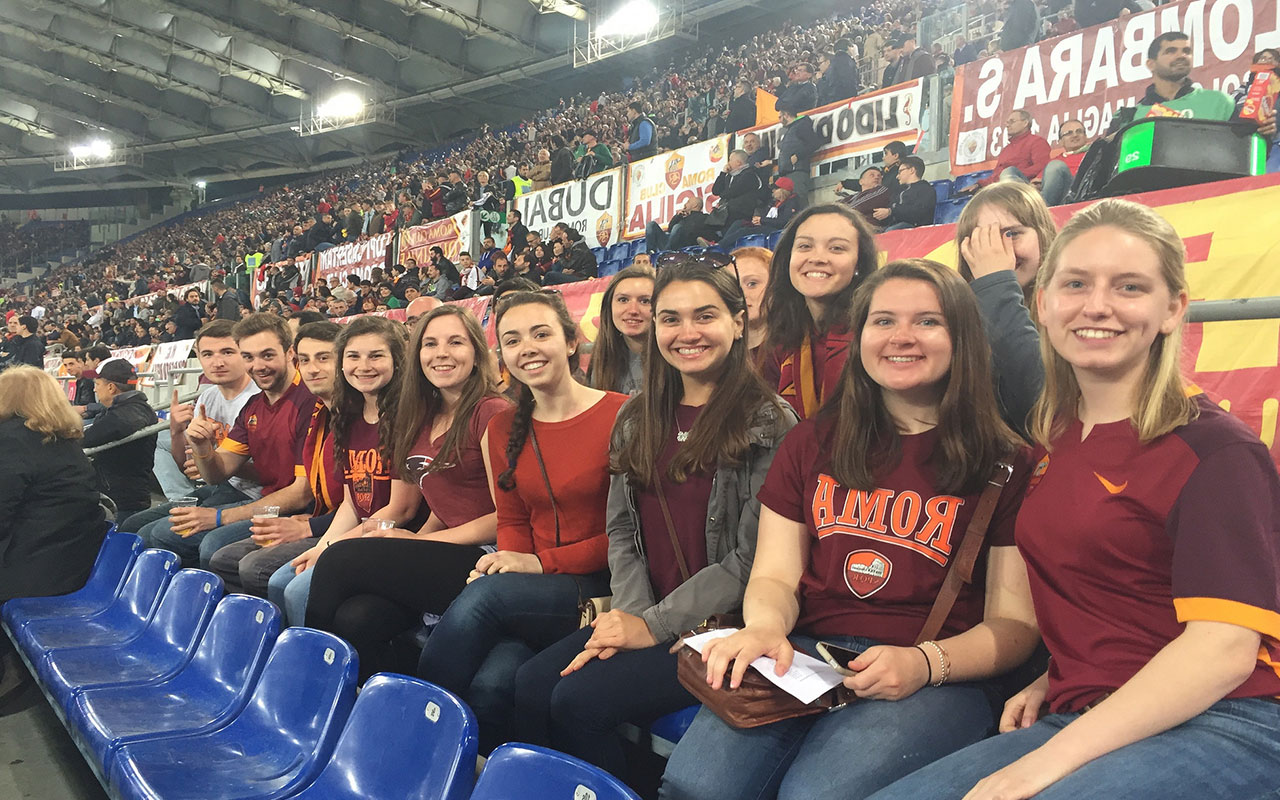 Assumption students enjoy a Roma football game in their downtime.