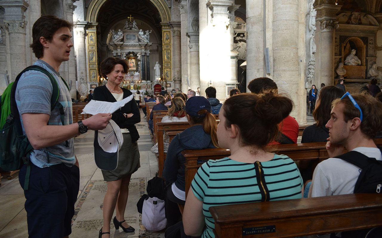Assumption students studying at the College's 罗马BBIN官网平台 in an art history class in the 541-year-old  Basilica of Santa Maria del Popolo.
