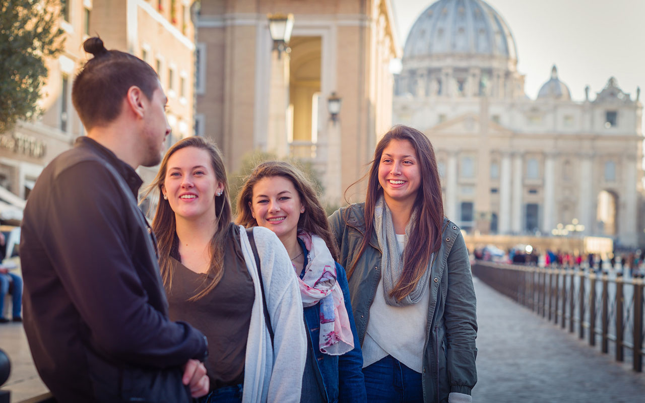 Assumption students studying at the College's campus in Rome, Italy pause outside of St. Peter's Basilica.